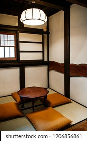 MAY 29, 2013 Matsumoto, JAPAN - Old Japanese houses interior with fabric cusion, wood table warm light from ceiling lamp and Tatami mat floor