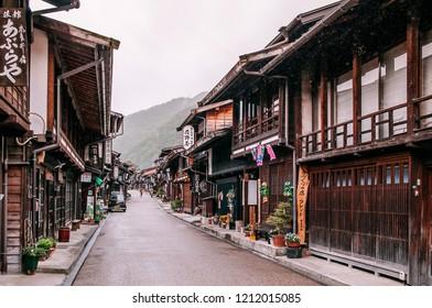MAY 29, 2013 Nagano, Japan - Old wooden house and narrow street of Narai Post town (Narai-Juku) the midpoint town on Nakasendo road, Edo period trading route between old Tokyo and Kyoto
