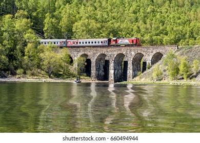 May 29, 2017: The train is traveling over the bridge on Circum-Baikal railway, Baikal lake, Russia