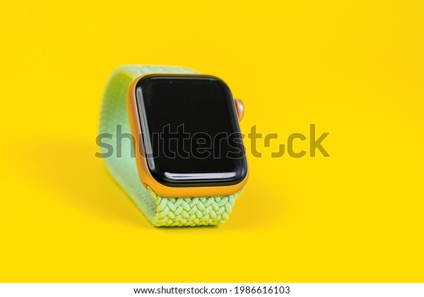 May 29 2021, Rostov, Russia: Apple Watch Series 6 with pistachio braided solo loop as a modern band on yellow background, copy space. Smart device for an active lifestyle.