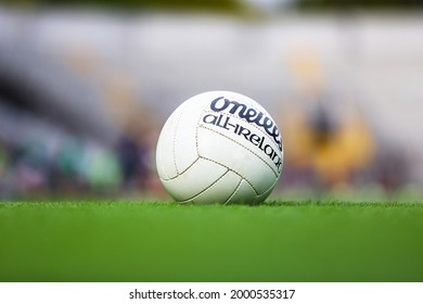 May 29th, 2021, Cork, Ireland - an O'Neills All Ireland Gaelic Football ball lies in the grass with an out of focus background