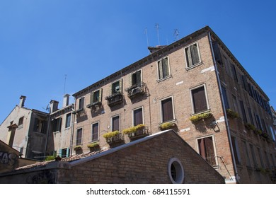May 2nd 2017 Venice, Italy - Beautiful architecture of Venice in sunny spring day. Close up of traditional Venetian style windows with window blinds.