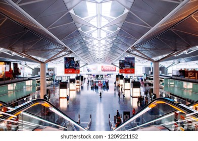 MAY 30, 2013 Nagoya, Japan - Modern Interior and truss ceiling structure with natural light from roof of Nagoya Chubu Centrair Airport . People and passengers at international airport