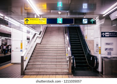 MAY 30, 2013 Nagoya, Japan - Empty platform escalator and stair of Meitetsu Nagoya Station with direction information lightbox sign hanging above - Vintage film style image