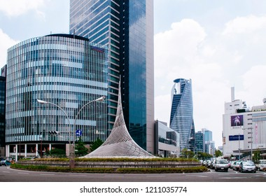 MAY 30, 2013 Nagoya, Japan - Modern glass wall skyscappers building at Nagoya station with famous spiral building - Mode Gakuen in financial district downtown