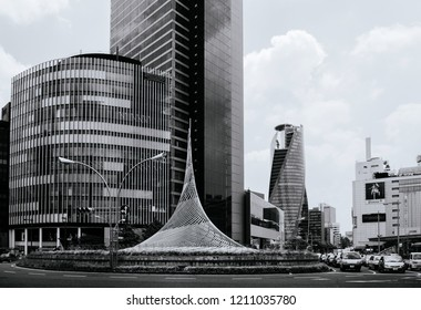 MAY 30, 2013 Nagoya, Japan - Modern glass wall skyscappers building at Nagoya station with famous spiral building - Mode Gakuen in financial district downtown - Black and white image