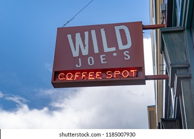 MAY 30 2018 - BOZEMAN, MT: Wild Joe's Coffee Spot is a coffee shop in downtown Bozeman Montana. Sunny day, sign is isolated
