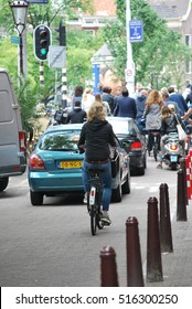 MAY 31, 2014. AMSTERDAM, NETHERLANDS: CIRCA: People going to work on bikes during morning rush hours.
