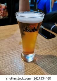 May 31, 2019 - chilled asahi peach beer in Unatoto restaurant - Bangkok, Thailand