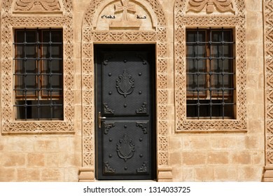 MAY 5, 2011 — MIDYAT, TURKEY. Intricate carvings decorate the stone facade, door, and windows of a building at Deyrulzafaran Monastery in Eastern Anatolia.