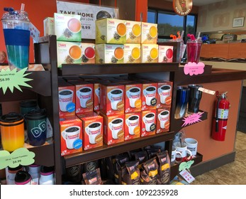 May 5 2018 - Minneapolis, MN: Shelf inside of a Dunkin Donuts coffee shop sells boxes of Dunkin Donuts branded k-cups for the Keurig coffee maker.