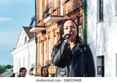 MAY 5 2018 , Minsk,Belarus Street walks A woman with a microphone sings on the street