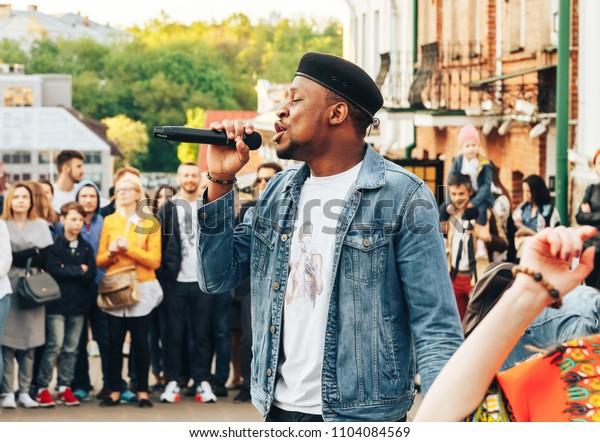 MAY 5 2018 , Minsk,Belarus Street walks A man sings among a group of people