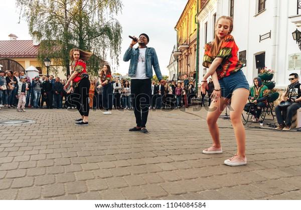 MAY 5 2018 , Minsk,Belarus Street walks Three girls are dancing outside, a man is singing