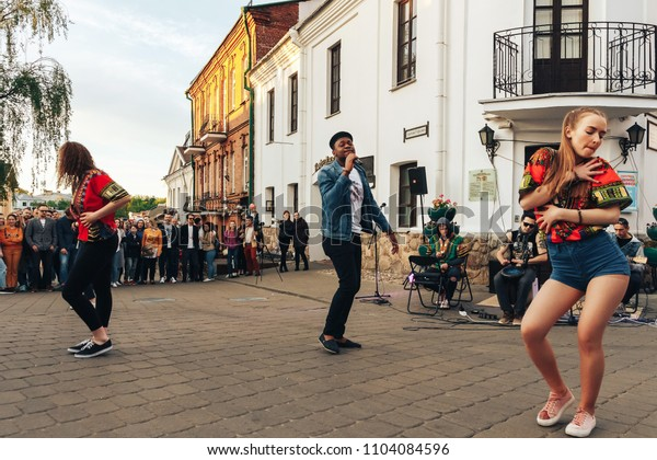 MAY 5 2018 , Minsk,Belarus Street walks Three girls are dancing outside, a man is singing