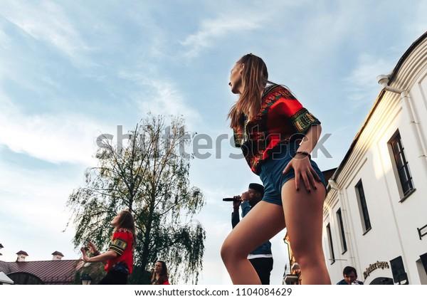 MAY 5 2018 , Minsk,Belarus Street walks Two girls are dancing outside, a man is singing