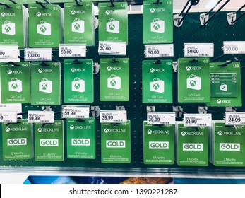 May 5 2019 - Plymouth, MN: Xbox and Xbox Live gift cards on sale at a store, displayed on a pegboard shelf. This is a Microsoft product