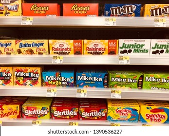 May 5 2019 - Plymouth, MN: Variety of boxed movie theater sized candy on display at a grocery store. Includes Skittles, Junior Mints, M&Ms and Mike and Ikes