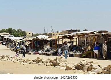 May, 6, 2019. The Pyramids of Giza, Cairo, Egypt. Traditional market with souvenir stalls beside great Pyramids and Sphinx in Giza. Local people are selling souvenirs to the tourists.