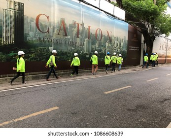 May 8, 2018 Bangkok:Construction workers are walk to the construction site in the morning near wireless road. They're migrants worker from Myanmar, Cambodia or other Thailand's neighbor countries.