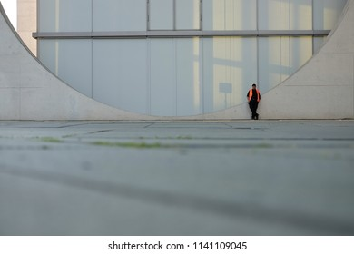 MAY 8, 2018: Worker doing his lunch break at the Marie-Elisabeth-Lüders-Haus in Berlin on a beautiful sunny day with blue sky.