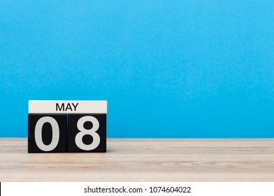 May 8th. Day 8 of month, calendar on blue background. Spring time, empty space for text. World Red Cross and red Crescent Day