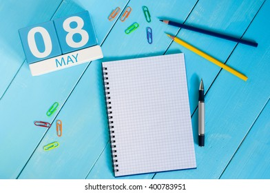 May 8th. Image of may 8 wooden color calendar on blue background.  Spring day, empty space for text.  World Red Cross and red Crescent Day