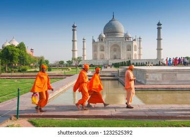 May 9, 2007. Pilgrims in traditional orange clothes at the Taj Mahal, Agra, Uttar Pradesh state, India.