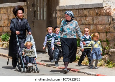 May 9, 2017. A traditional orthodox Judaic family with the child on the Mea Shearin street in Jerusalem, Israel.