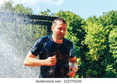 MAY 9 2018 , Minsk,Belarus Annual action in honor of the day of victory The Race of the Valiant The man runs under the water hose