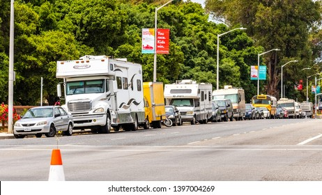 May 9, 2019 Palo Alto / CA / USA - Campers and RVs parked on the side of El Camino Real, close to Stanford in San Francisco bay area, Silicon Valley; symbol of housing crisis