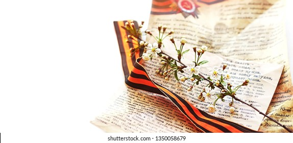 May 9, Victory Day. St.George ribbon,  letter and  branch of cherry blossoms. celebration of Victory Day 1945. holiday Victory Day background. soft focus, copy space, banner. Russia, Saransk, may 2016