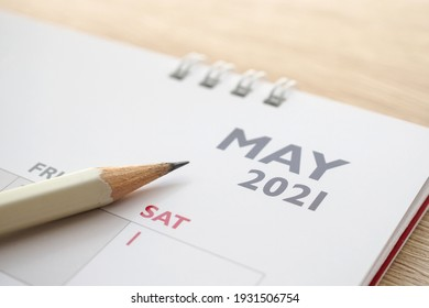 May month on 2021 calendar page with pencil business planning appointment meeting concept