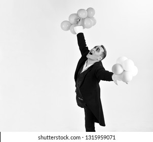 May your birthday be filled with joy. Man with mime makeup on birthday party. Mime man with party balloons. Happy birthday or anniversary celebration. Balloon artist. Holding festive celebration.
