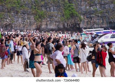Maya Bay Beach, Ko Phi Phi Le, Thailand - September 10, 2017. The beach and bay are overcrowded with tourists because it is now a honeypot or bucket list tourist destination causing temporary closure