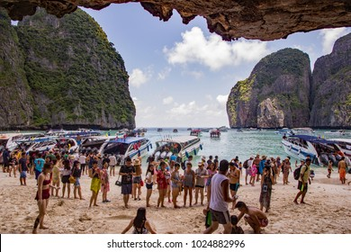 Maya Bay Beach, Phi Phi Islands, Thailand - September 10, 2017. The beach and bay are overcrowded with tourists because it is now a honeypot or bucket list tourist destination. Known as overtourism