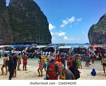Maya Bay Beach, Phi Phi Islands, Thailand - September 10, 2017. The beach and bay are overcrowded with tourists and boats because it is a honeypot destination causing its temporary closure