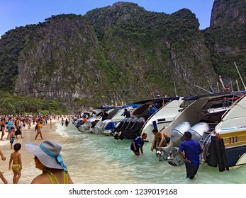 Maya Bay Beach, Phi Phi Islands, Thailand - September 10, 2017. The beach and bay are overcrowded with tourists because it is now a honeypot or bucket list tourist destination causing its temporary cl