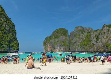 Maya Bay, Krabi, Thailand, - December 15 2017: Beach in famous Maya Bay floaded with tourists and tourist boats