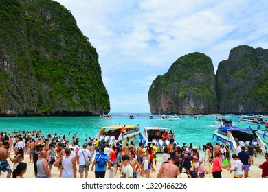 MAYA BAY, PHI PHI LEH, THAILAND - OCTOBER 1, 2015 : Famous crowded beautiful beach in Maya Bay. Maya Bay is closed due to damage to the coral reef by boats and intense tourism.