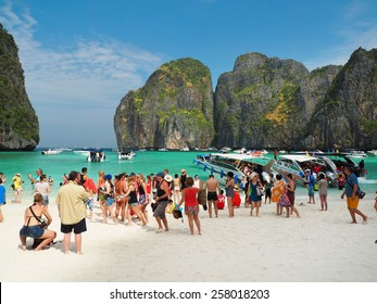 MAYA BAY, THAILAND - FEBRUARY, 2015: Crowds of visitors enjoy a day trip at Maya Bay, one of the iconic beaches of  Phi Phi  islands of Southern Thailand.