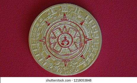 Maya calendar coin and the change of eras