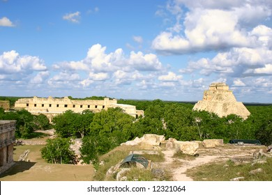 Maya ruins Uxmal in mexican Yucatan with green forest