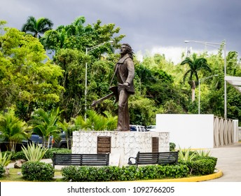 Mayaguez, Puerto Rico/USA-April 20, 2018: Statue of Puerto Rican Singer Wilkins on the grounds of the Sports Palace