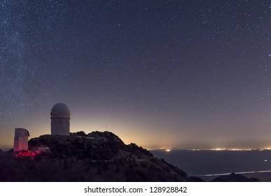 The Mayall observatory at Kitt Peak overlooks Tucson, Arizona on a clear starry night