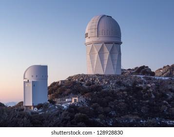 The Mayall Observatory sits atop Kitt Peak at sunset, awaiting darkness.