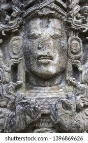 Mayan Face Carved in Stone Temple Building in World Famous Copan Ruins Archeological Site of ancient Maya Civilization, a UNESCO World Heritage Site in Honduras near Guatemala Border
