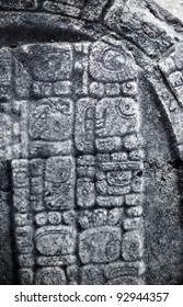 Mayan hieroglyphics carved in stone