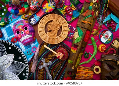 Mayan mexican handcrafts souvenirs carved skulls embroidery
