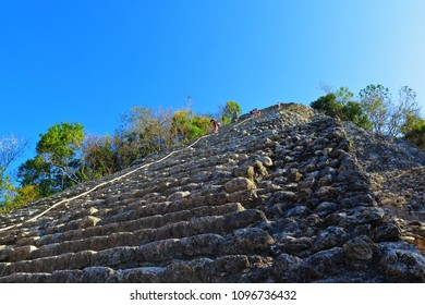 Mayan pyramid Nohoch Mul in Coba. Tourists climbing on the Coba pyramid. Temple in the archaeological site of Cobá, Mexico.